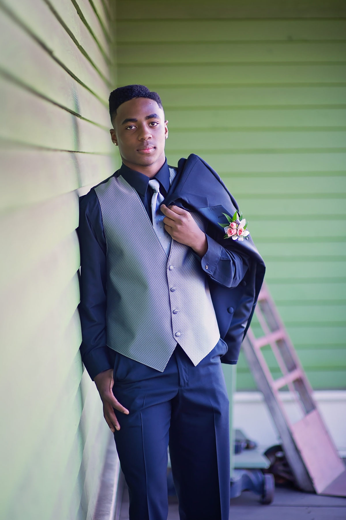 young black man posing in a suit