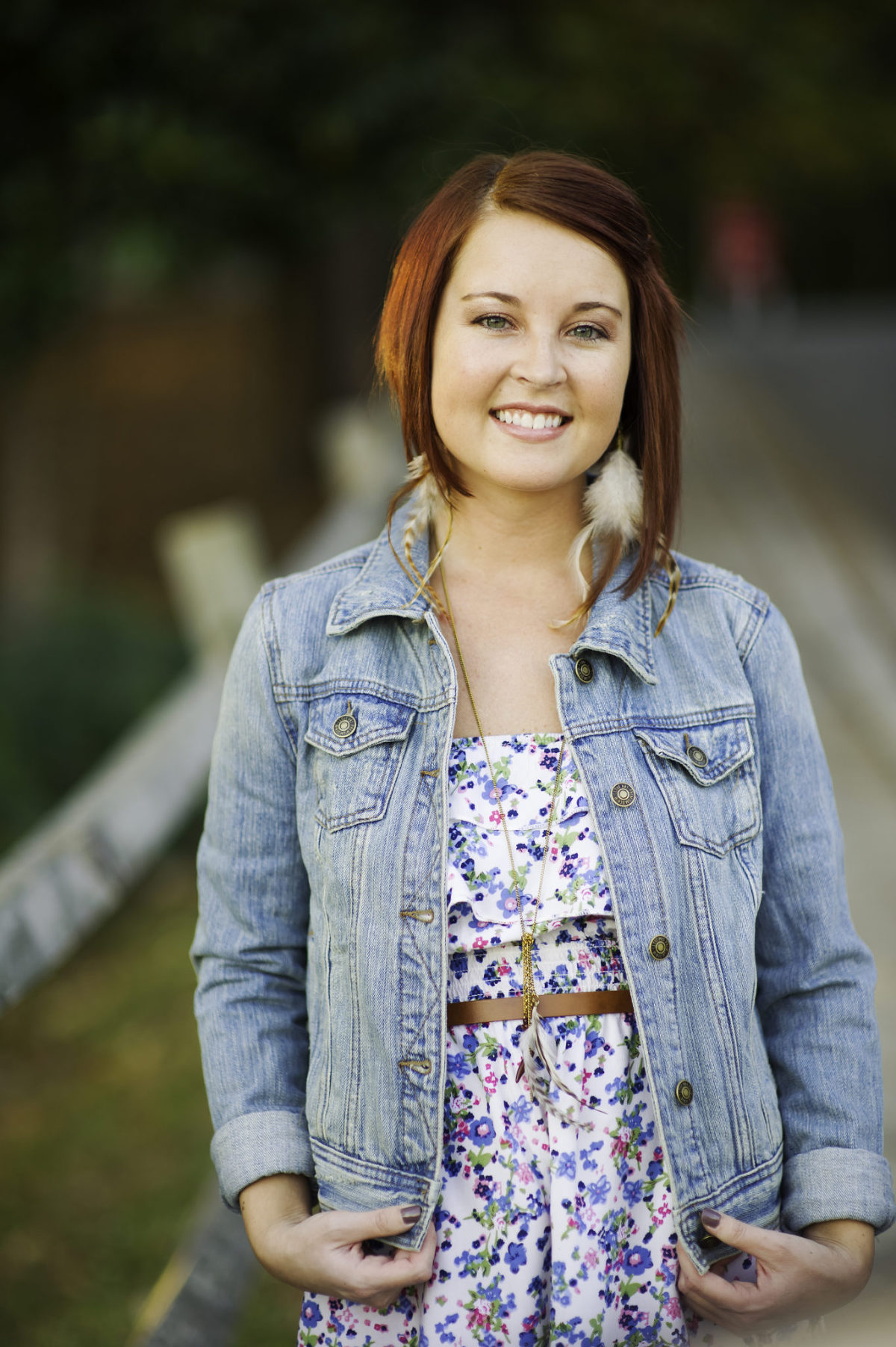 Young woman with read hair wearing a blue jean jacket